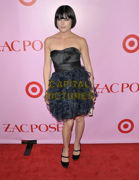 SELMA BLAIR .Zac Posen For Target Collection Launch held at the New Yorker Hotel, New York, NY, USA, 15th April 2010..full length black strapless navy blue ruffles ruffle dress mary janes shoes heels pointy fringe bob .CAP/ADM/BM.©Bill Menzel/AdMedia/Capital Pictures.