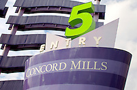 Photography of Concord Mills Mall, a 1.4 million-square-foot mall located in Concord, NC, about 12 miles from Charlotte, NC. Concord Mills is located about a mile from Charlotte Motor Speedway. It attracts tens of millions of visitors each year. Photo is part of a photographic series of images featuring Concord, NC, by photographer Patrick Schneider.