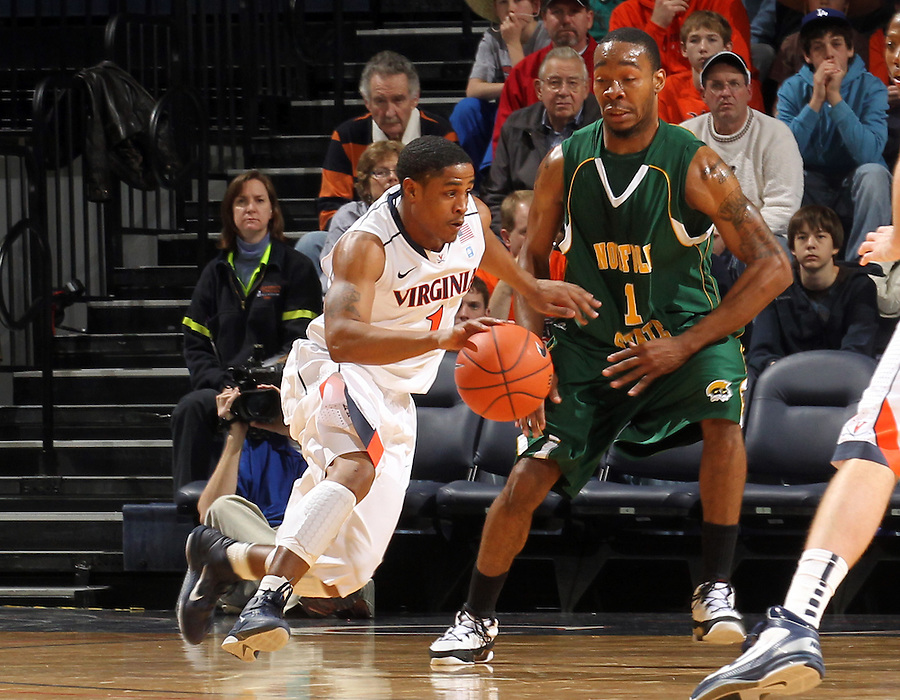 Dec. 20, 2010; Charlottesville, VA, USA; Virginia Cavaliers guard Jontel Evans (1) drives past Norfolk State Spartans guard/forward Rob Hampton (1) during the game at the John Paul Jones Arena. Mandatory Credit: Andrew Shurtleff-