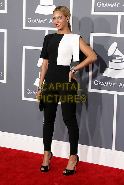 Beyonce Knowles.The 55th Annual GRAMMY Awards held at STAPLES Center Los Angeles, California, USA..February 11th, 2013.full length black whit top hand on hip trousers brown bracelets clutch bag ankle strap pep toe shoes.CAP/ADM.©AdMedia/Capital Pictures.