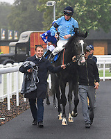 Winner of The British EBF Molson Coors Novice Stakes Div 1 Ascension ridden by Jack Mitchell and trained by Roger Varian is led into the Winners enclosure during Horse Racing at Salisbury Racecourse on 14th August 2019