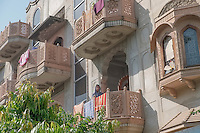 Daily life is displayed on the multi-level balconies of inner-city Jaipur.