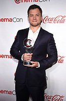 "LAS VEGAS, NV - APRIL 26: Recipient of the ""Action Star of the Year"", Taron Egerton attends the CinemaCon Big Screen Achievement Awards at CinemaCon 2018 at The Colosseum at Caesars Palace on April 26, 2018 in Las Vegas, Nevada. (Photo by Frank Micelotta/PictureGroup)"