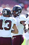 Southern Illinois Salukis tight end MyCole Pruitt (4) congratulates Southern Illinois Salukis wide receiver John Lantz (13). The Southern Illinois University - Carbondale (SIUC) Salukis defeated the host Southeast Missouri State University (SEMO) Redhawks 36-19 in an NCAA football game at Busch Stadium on Saturday September 21, 2013.