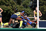 14 November 2015: Michigan's Courtney Enge (22) scores the first goal past Wake Forest's Valerie Dahmen (in blue). The Wake Forest University Demon Deacons played the University of Michigan Wolverines at Francis E. Henry Stadium in Chapel Hill, North Carolina in a 2015 NCAA Division I Field Hockey Tournament First Round match. Michigan won the game 2-1.
