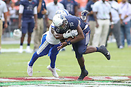 Washington, DC - September 16, 2016: Howard Bison quarterback Kalen Johnson (15) gets tackled during game between Hampton and Howard at  RFK Stadium in Washington, DC. September 16, 2016.  (Photo by Elliott Brown/Media Images International)