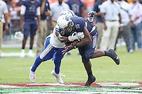 Washington, DC - September 16, 2016: Howard Bison quarterback Kalen Johnson (15) gets tackled during game between Hampton and Howard at  RFK Stadium in Washington, DC. September 16, 2016.  (Photo by Elliott Brown/Media Images International)