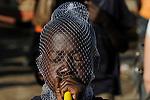 ZAMBIA Barotseland Mongu, Mulamba harbour at river Zambezi floodplain, boy with plastic net and Vuvuzela / SAMBIA Barotseland , Stadt Mongu , Hafen Mulamba in der Flutebene des Zambezi Fluss, Junge mit einer Vuvuzela und Plastiknetz auf dem Kopf