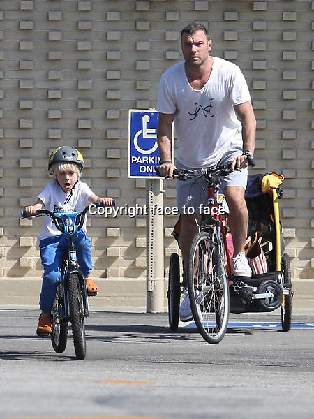 BRENTWOOD, CA - FEBRUARY 23: Liev Schreiber with sons Alexander and Sasha enjoy a day of bike riding and climging in Brentwood, California on February 23, 2014. Credit: MediaPunch<br /> Credit: MediaPunch/face to face<br /> - Germany, Austria, Switzerland, Eastern Europe, Australia, UK, USA, Taiwan, Singapore, China, Malaysia, Thailand, Sweden, Estonia, Latvia and Lithuania rights only -