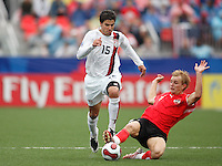 Austria midfielder (11) Peter Hackmair goes for a tackle on USA midfielder (15) Sal Zizzo. Austria (AUT) defeated the United States (USA) 2-1 in overtime of a FIFA U-20 World Cup quarter-final match at the National Soccer Stadium at Exhibition Place, Toronto, Ontario, Canada, on July 14, 2007.