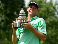 June 30, 2013  (Bethesda, Maryland)  Bill Haas holds the AT&T National Championship trophy after winning the tournament. Hass finished 12-under, three strokes ahead of Roberto Castro.  (Photo by Don Baxter/Media Images International)