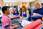 Dec. 12, 2012 - Garden City, New York, U.S. - Merrick School District adminstrators, R-L, LISA RUIZ, ROSEMARY SYREN, DR. CHRISTINE GRUCCI, and SAL DOSSENA, help the Merrick Kiwanis Club, a community service group, wrap gifts at Roosevelt Field mall in Long Island, to raise funds to use for charity, during the busy winter holiday shopping season. Kiwanis member MARTY DILLON, behind Syren, also helped wrap presents. Some ways Kiwanis helps the community are by providing food, clothing, and school supplies to those in need, sending children to Kamp Kiwanis, providing scholarships and hosting a Harvest Ball for senior citizens.