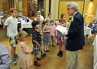 NWA Democrat-Gazette/MICHAEL WOODS &bull; @NWAMICHAELW<br /> Daniel Levine, a member of Temple Shalom of Northwest Arkansas, gathers the children together to prepare them to search for the afikomen during the Passover Seder on Saturday, April 23, 2016, in Fayetteville.  A traditional activity during the Seder is for adults to hide the afikomen, a ceremonial broken half of matzah, for the children to find at the end of the Seder service.