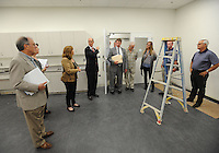 NWA Democrat-Gazette/ANDY SHUPE<br /> Peter Lane (center), president and CEO of the Walton Arts Center, speaks Tuesday, Sept. 22, 2015, with Wendy Riggs, vice president of operations for the center, during a tour of the new administrative offices being constructed as part of Fayetteville&rsquo;s $12.3 million municipal parking deck project. The arts center contributed more than $2.2 million to the project which will house administrative staff and include additional back-of-house space for the performing arts center. Visit nwadg.com/photos to see more photographs from the tour.