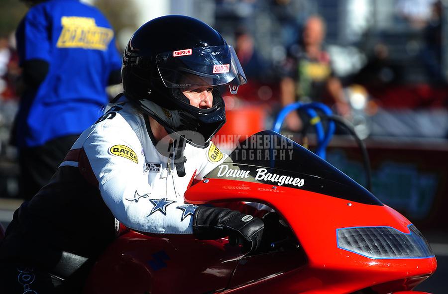 Nov 11, 2010; Pomona, CA, USA; NHRA pro stock motorcycle rider Dawn Baugues during qualifying for the Auto Club Finals at Auto Club Raceway at Pomona. Mandatory Credit: Mark J. Rebilas-