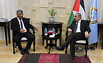 Palestinian Prime Minister Mohammad Ishtayeh meets with Walid Assaf, chairman of the Commission against the Wall and Settlements, at his headquarter, in the West Bank city Ramallah, August 25, 2019. Photo by Prime Minister Office