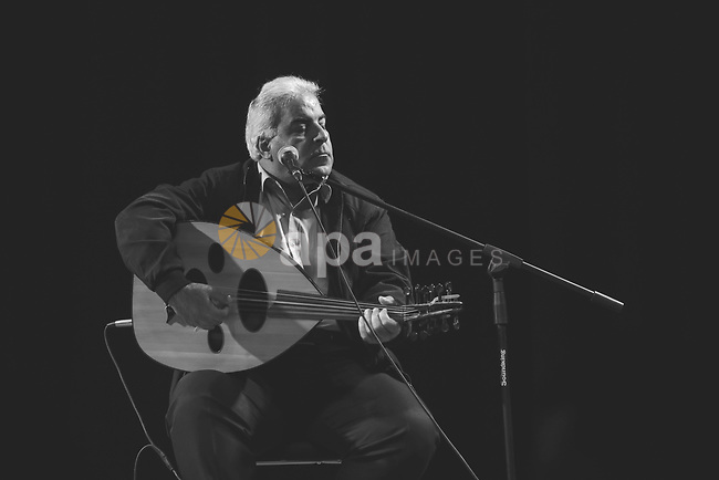 "An old man plays on ""Oud"" with Black and White. Photo by Sanad Ltefa"
