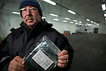 Professor Roland von Bothmer of the Swedish University of Agriculture showing a bag of seeds donated by Germany for storage in the Global Seed Vault in Svalbard, Norway.