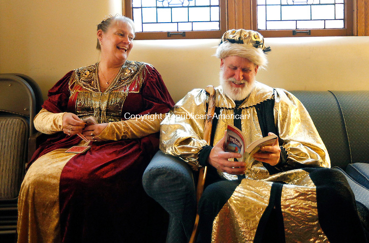 Winsted, CT- 09 January 2016-010916CM06-  Barbara Mazzei, left, of Winsted and Dave Pastorello of Torrington get ready during the First Church of Winsted's 26th annual Boar's Head Festival in Winsted on Saturday. The Medieval celebration of the Epiphany, featured period costumes, live animals, the Laurel City Singers choir, a brass ensemble, pipers, dancers and drummers.  An additional seating of the festival will be held on Sunday at 3:30 p.m. with doors opening and pre-show performances one half-hour before the show time. Tickets are $9 for children 12 and under, $12 for seniors and $15 for adults.  Proceeds will benefit the Sharon Lewis Memorial Scholarship Fund and the Open Door Soup Kitchen.  Christopher Massa Republican-American