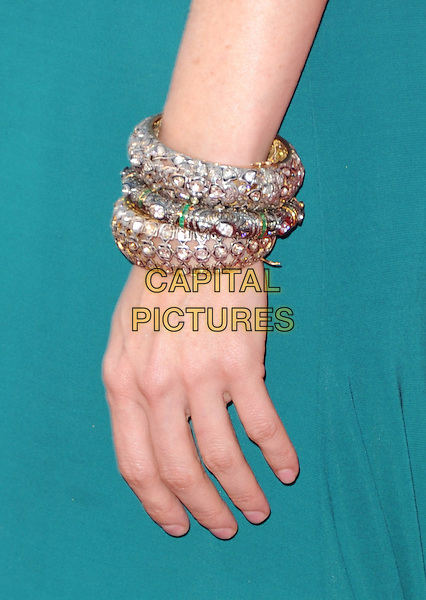 "Heather Graham's hand.""The Hangover Part III"" Los Angeles Premiere held at the Westwood Village Theater, Los Angeles, California, USA..May 20th, 2013.bracelet snake gold wrist jewellery jewelry diamonds  green  detail.CAP/DVS.©DVS/Capital Pictures"