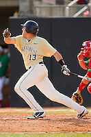 Stephen Schoettmer #13 of the Wake Forest Demon Deacons follows through on his swing against the North Carolina State Wolfpack at Doak Field at Dail Park on March 17, 2012 in Raleigh, North Carolina.  The Wolfpack defeated the Demon Deacons 6-2.  (Brian Westerholt/Four Seam Images)