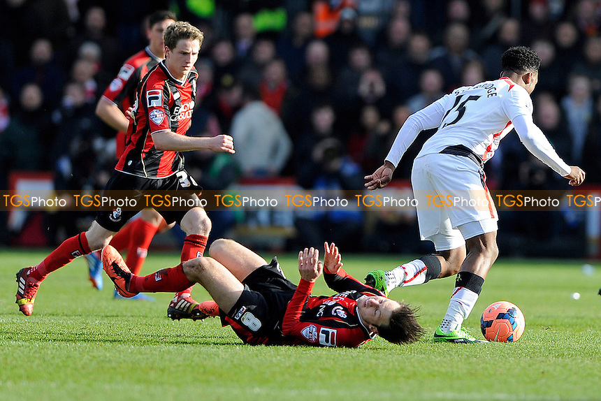 Harry Arter of AFC Bournemouth goes down as Daniel Sturridge of Liverpool takes the ball foeward - AFC Bournemouth vs Liverpool - FA Cup 4th Round Football at the Goldsands Stadium, Bournemouth, Dorset - 25/01/14 - MANDATORY CREDIT: Denis Murphy/TGSPHOTO - Self billing applies where appropriate - 0845 094 6026 - contact@tgsphoto.co.uk - NO UNPAID USE