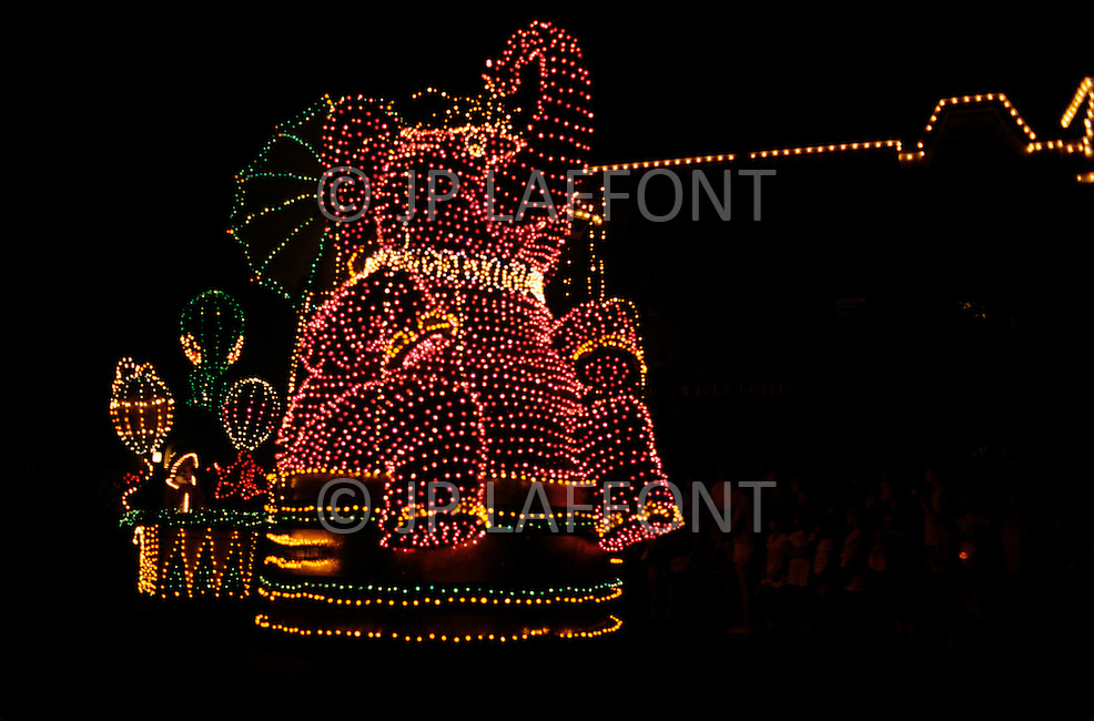 Orlando, Florida - Circa 1986. Disney character Dumbo at the Main Street Electrical Parade. The Main Street Electrical Parade was created by Bob Jani and Ron Miziker, and first appeared at Disney World on June 11, 1977. Disney World is a world-renowned entertainment complex that opened October 1, 1971 in Lake Buena Vista, FL. Now known as the Walt Disney World Resort, the property covers 25,000 acres and has an annual attendance of 52.5million people.