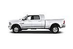 Car driver side profile view of a 2017 Ram 3500 Laramie 4 Door Van