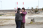 March 11, 2016, Tokyo, Japan - Relatives of tsunami victims hug each other as they meet to offer prayers for the victims of tsunami and earthquake on the area destroyed by the tsunami at Namie in Fukushima prefecture near the crippled TEPCO's nuclear plant on Friday, March 11, 2016 on the fifth anniversary of the Great East Japan Earthquake and Tsunami.  (Photo by Yoshio Tsunoda/AFLO)