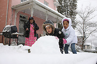 Kids make a snowman in Charlottesville, Va.