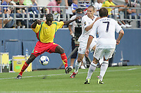 Cassim Langainge (4) tries to maintain control against Heath Pearce (center) and Robbie Rogers (7). USA defeated Grenada 4-0 during the First Round of the 2009 CONCACAF Gold Cup at Qwest Field in Seattle, Washington on July 4, 2009.