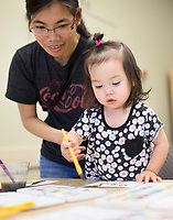 """NWA Democrat-Gazette/CHARLIE KAIJO Van Maness of Bentonville paints with MyLinh Maness, 21 months, during the """"How-To"""" festival, Saturday, March 24, 2018 at the Bentonville Library in Bentonville. <br /><br />Participants learned how to create a Duck Tape® corner bookmark, design a balloon rocket racer, discover finger knitting, write a Haiku poem, paint a watercolor masterpiece and learn about BookFlix®"""