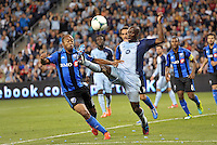 Ike Opara (3) defender Sporting KC gets to the ball ahead of Colleen Warner (18) midfield Montreal Impact .<br />