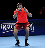 Jack Sock having fun with partner Mike Bryan during their victory lap after winning against Pierre-Hughes Herbert and Nicolas Mahut in their doubles Final match today<br /> Photographer Hannah Fountain/CameraSport<br /> <br /> International Tennis - Nitto ATP World Tour Finals Day 8 - O2 Arena - London - Sunday 18th November 2018<br /> <br /> World Copyright &copy; 2018 CameraSport. All rights reserved. 43 Linden Ave. Countesthorpe. Leicester. England. LE8 5PG - Tel: +44 (0) 116 277 4147 - admin@camerasport.com - www.camerasport.com