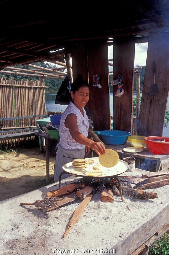 Woman cooking tortillas over a wood fire, Lagunas de Montebello National Park, Chiapas, Mexico