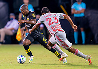 16th July 2020, Orlando, Florida, USA;  New York Red Bulls midfielder Cristian Casseres Jr (23) defends against Columbus Crew midfielder Darlington Nagbe (6) during the MLS Is Back Tournament between the Columbus Crew SC versus New York Red Bulls on July 16, 2020 at the ESPN Wide World of Sports, Orlando FL.