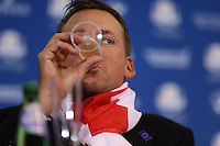 Ian Poulter (EUR) sips champagne at  the final European Team Press Conference after Sunday's Singles at the 2014 Ryder Cup from Gleneagles, Perthshire, Scotland. Picture:  David Lloyd / www.golffile.ie