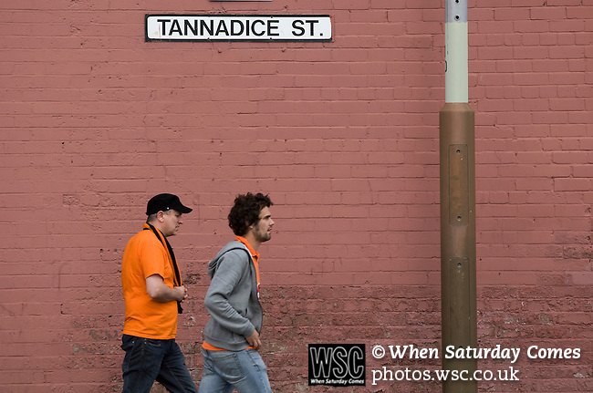 Dundee United 0 Dunfermline Athletic 1, 20/08/2011. Tannadice Park, Scottish Premier League. Fans making their way along Tannadice Street, Dundee towards Tannadice Park, home of Dundee United on the day they played host to Dunfermline Athletic in a Scottish Premier League match. The visitors won the game by one goal to nil, watched by a crowd of 6,527. Dundee United's stadium was situated on the same street as their city rival Dundee, whose Dens Park ground was situated a few hundred yards away.