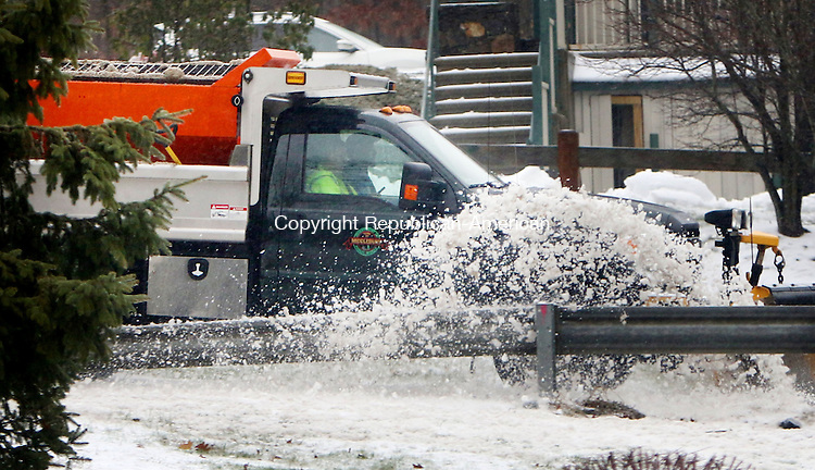 MIDDLEBURY CT. 29 December 2015-122915SV03-A town plowtruck clears snow from Middlebury Road in Middlebury Tuesday.<br /> Steven Valenti Republican-American