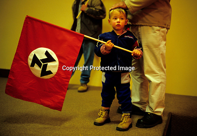 POTCHEFSTROM, SOUTH AFRICA - JUNE 12: .Unidentified members of AWB, a right wing movement, hold their flags on June 12, 2004 in central Potchefstrom, South Africa. Eugene Terre Blanche, the leader of the movement, was released from prison earlier in the day. Mr. Terre Blanche served five years for assaulting a black man. The AWB movement tried to disrupt the first democratic election in the country in 1994. A series of bombs and attacks were blamed on AWB members leading up to Election Day. .(Photo: Per-Anders Pettersson/Getty Images).
