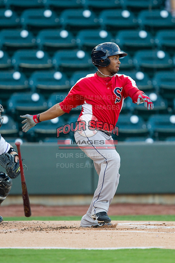 Keury De La Cruz (25) of the Salem Red Sox follows through on his swing against the Winston-Salem Dash at BB&T Ballpark on August 15, 2013 in Winston-Salem, North Carolina.  The Red Sox defeated the Dash 2-1.  (Brian Westerholt/Four Seam Images)