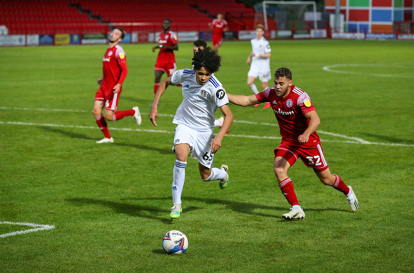 Leeds United U21's Jeremiah Mullen battles with Accrington Stanley's Dion Charles<br /> <br /> Photographer Alex Dodd/CameraSport<br /> <br /> EFL Trophy Northern Section Group G - Accrington Stanley v Leeds United U21 - Tuesday 8th September 2020 - Crown Ground - Accrington<br />  <br /> World Copyright © 2020 CameraSport. All rights reserved. 43 Linden Ave. Countesthorpe. Leicester. England. LE8 5PG - Tel: +44 (0) 116 277 4147 - admin@camerasport.com - www.camerasport.com