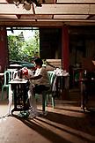 PHILIPPINES, Palawan, Puerto Princesa, Marilyn Andao sews at the Central Puerto Princesa Mitra Amphitheater