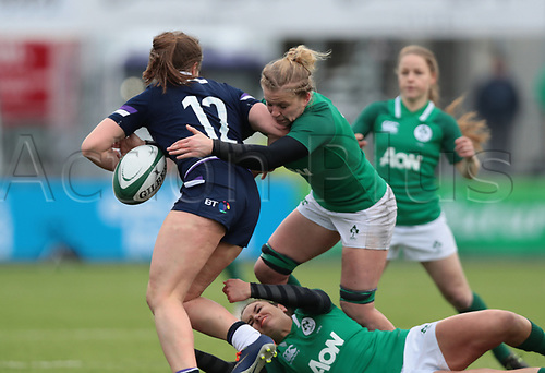 11th March 2018, Donnybrook Stadium, Dublin, Ireland; Womens Six Nations rugby, Ireland Women versus Scotland Women; Claire Molloy (Ireland) dislodges the ball in the tackle of Helen Nelson (Scotland)