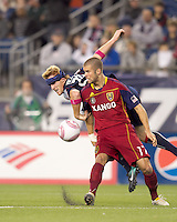 Real Salt Lake defender Chris Wingert (17) attempts to control the ball as New England Revolution defender Pat Phelan (28) closely defends. Real Salt Lake defeated the New England Revolution, 2-1, at Gillette Stadium on October 2, 2010.
