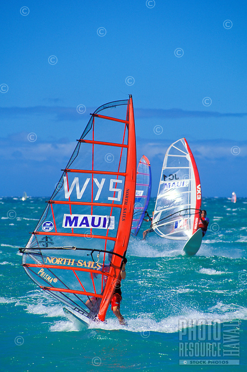 Windsurfers enjoy a day at Hookipa Beach Park. Maui's best and most popular beach park for surfing and windsurfing is just outside the town of Paia on the Hana Highway. Ho'okipa means hospitality in Hawaiian.
