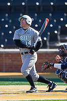 Andrew Dundon (14) of the Marshall Thundering Herd follows through on his swing against the Georgetown Hoyas at Wake Forest Baseball Park on February 15, 2014 in Winston-Salem, North Carolina.  The Thundering Herd defeated the Hoyas 5-1.  (Brian Westerholt/Four Seam Images)