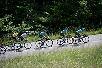 yellow jersey / GC leader Jakob Fuglsang (DEN/Astana) in the bunch, escorted by his teammates<br /> <br /> Stage 8: Cluses (FRA) to Champéry (SUI)(113km)<br /> 71st Critérium du Dauphiné 2019 (2.UWT)<br /> <br /> ©kramon