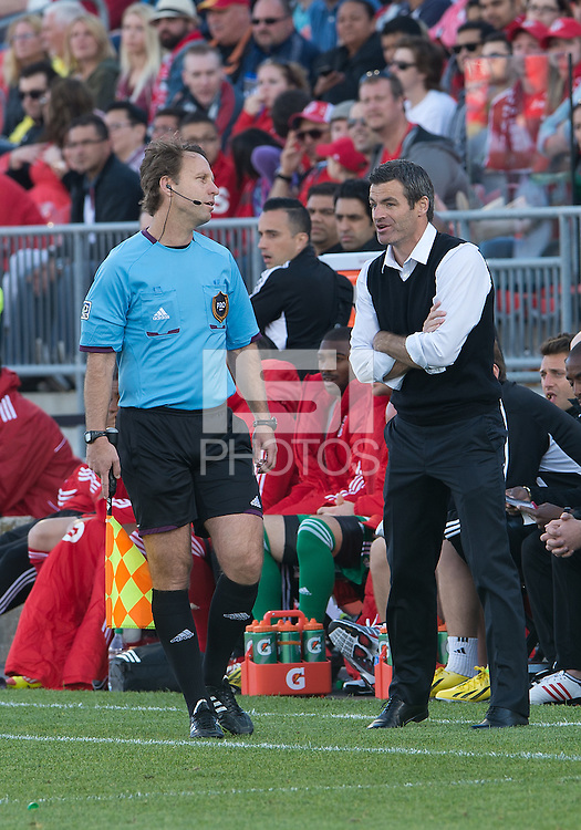 18 May 2013: Toronto FC head coach Ryan Nelsen talks with the referee's assitant during an MLS game between the Columbus Crew and Toronto FC at BMO Field in Toronto, Ontario Canada..The Columbus Crew won 1-0...