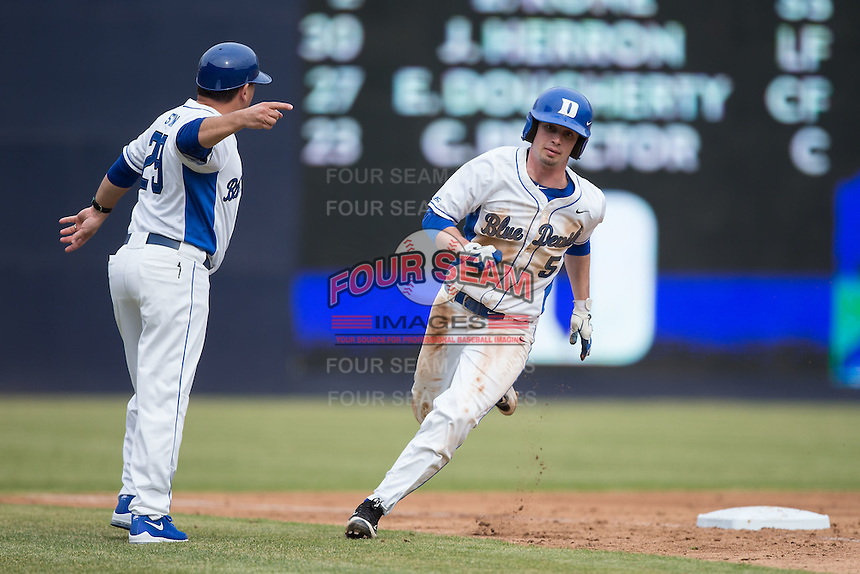 Duke Blue Devils third base coach Jason Stein (29) tells Max Miller (5) to go home during the game against the California Golden Bears at Durham Bulls Athletic Park on February 20, 2016 in Durham, North Carolina.  The Blue Devils defeated the Golden Bears 6-5 in 10 innings.  (Brian Westerholt/Four Seam Images)